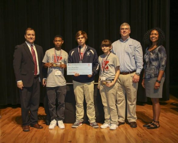 Second Place 11/12 – Quest (MP STEM Team), Moss Point Career and Technical Education Center, Moss Point (pictured from left): Jarrod Ravencraft, MDOT Public Affairs Division Director; Kobe Sanders; Jacob Maki; Sabrina Gonzalez; Matt Dunn, National TRAC Program Co-Chair and MDOT District 1 Maintenance Engineer; and, Selena Standifer, MDOT Public Affairs Division Deputy Director.